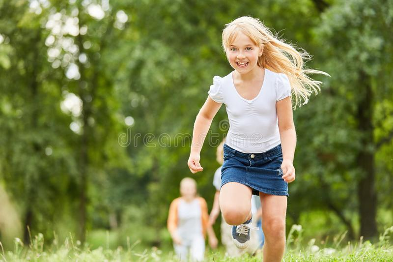 Blond girl makes a race stock image