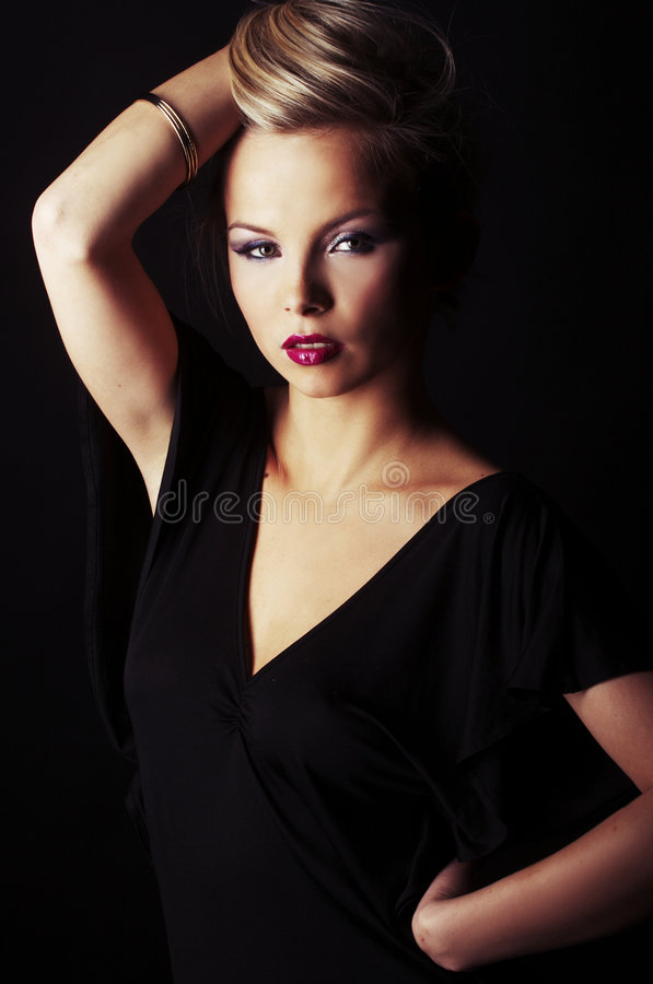 Free Blond Girl On Black Background Stock Photography - 7677202