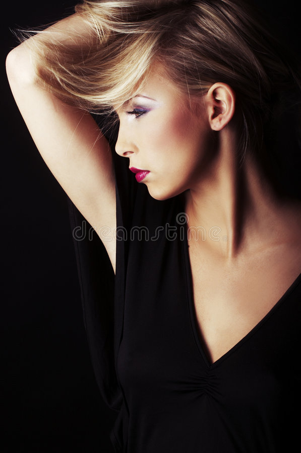 Free Blond Girl On Black Background Stock Images - 7677384