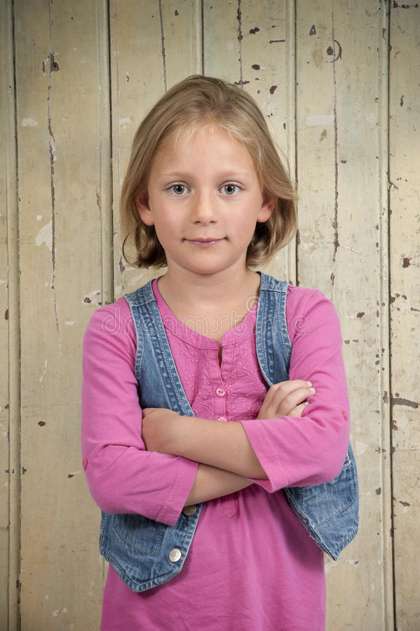 Download Blond Girl In Pink, Arms Crossed Stock Photo - Image: 26469730