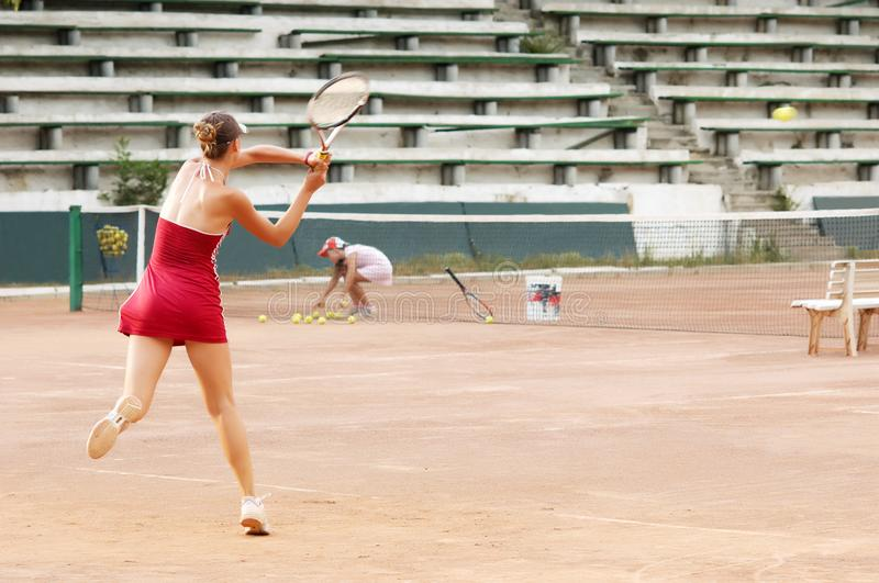 Blond girl playing tennis royalty free stock image