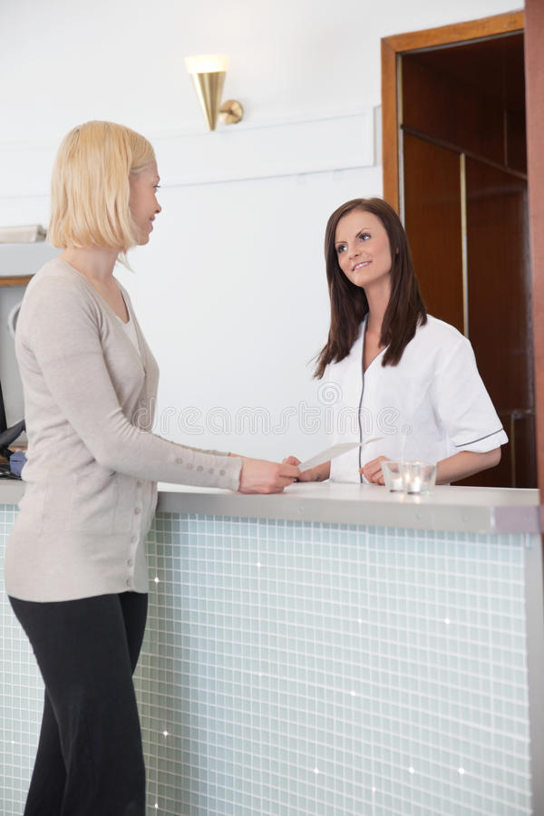 Blond girl at the reception desk royalty free stock image