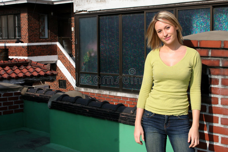 Download Blond girl on roof top stock image. Image of feminine, house - 637973