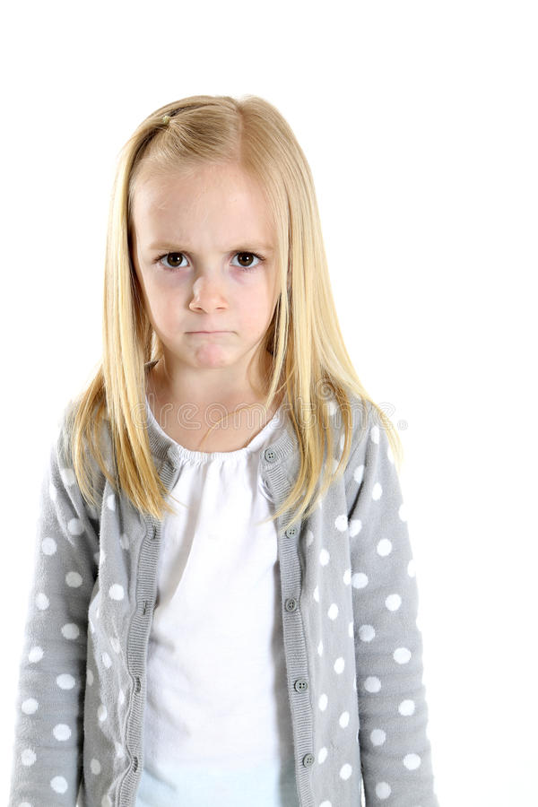 Blond girl with a sad hurt frustrated angry frowning expression stock photos