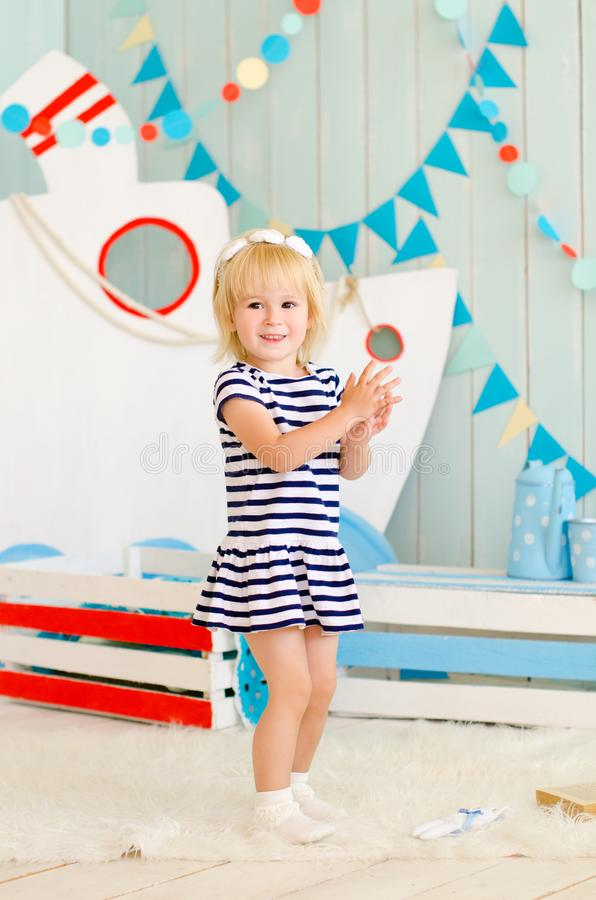 blond girl standing against a background of decorative craft stock images
