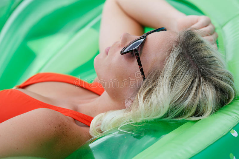 Blond girl sun bathing stock images