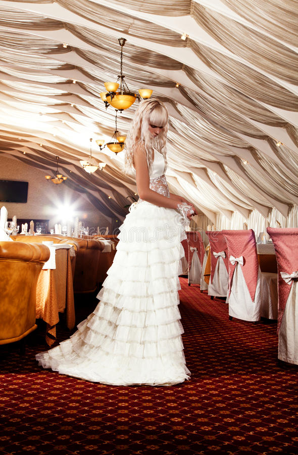 Download Blond Girl In A Wedding Dress Posing At Restaurant Stock Image - Image: 19225141