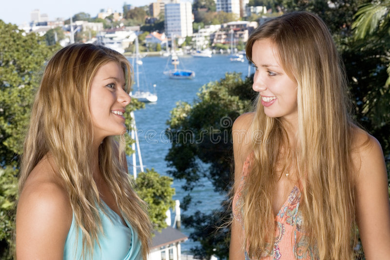 Blond girlfriends chatting stock photo