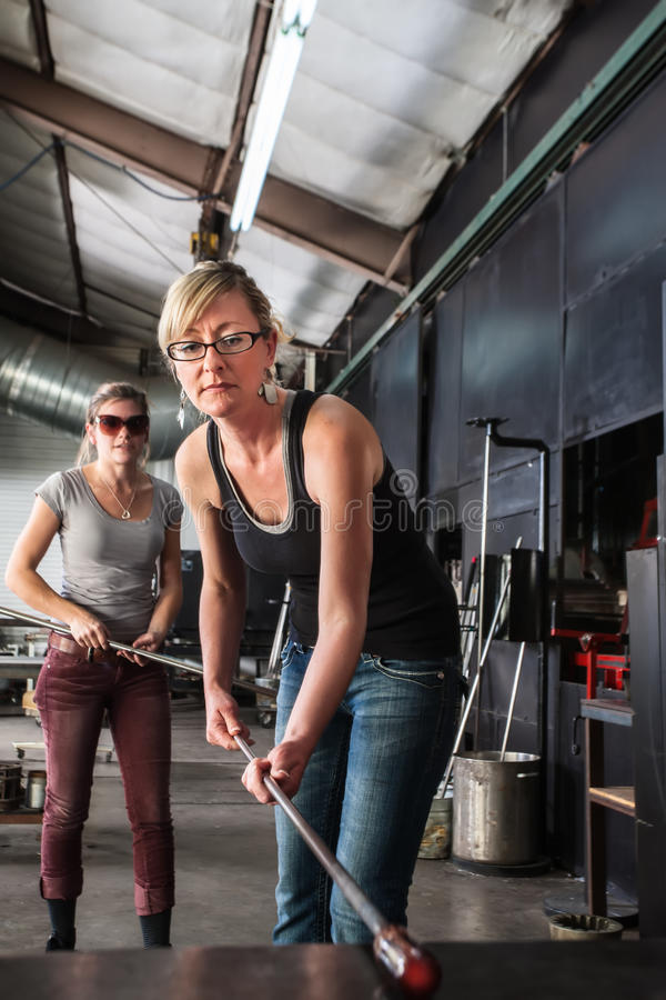 Lady Working with Molten Glass royalty free stock photography