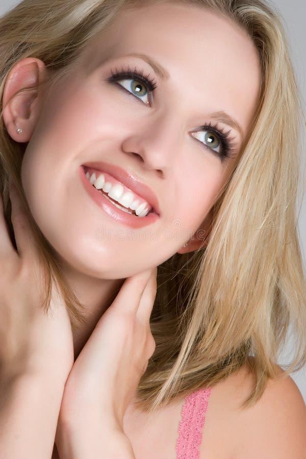 Blond glimlachen stock afbeelding