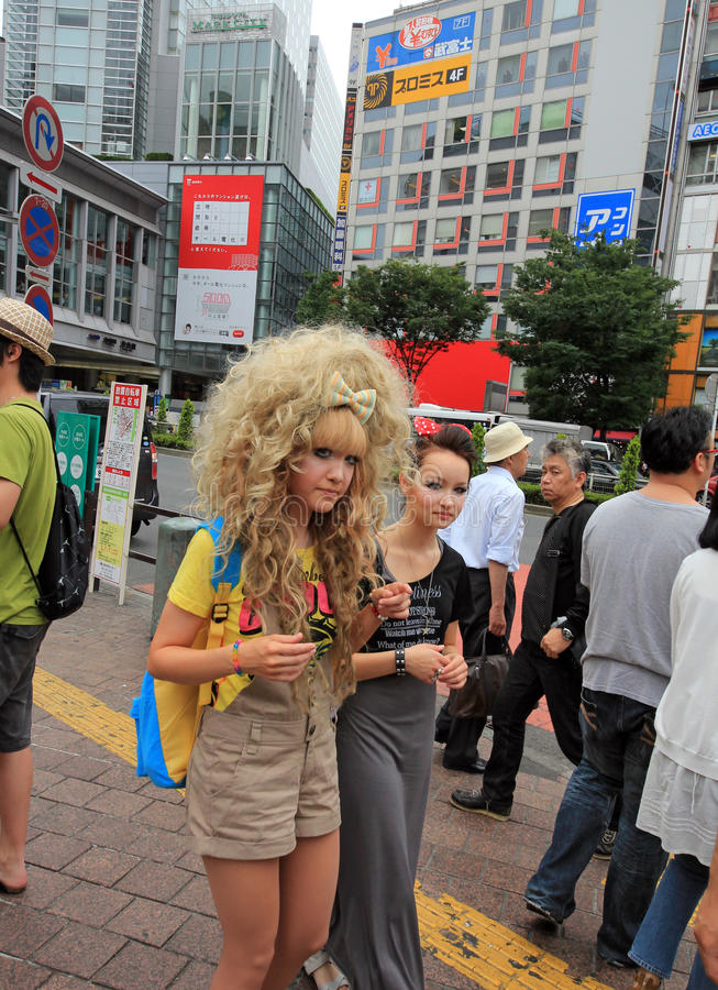 Blond gothic lolita at the Shibuya crossing, tokyo. Tokyo, Japan - June 26, 2010 - Blond gothic lolita at the Shibuya crossing on June 26, 2010. Shibuya district royalty free stock photography
