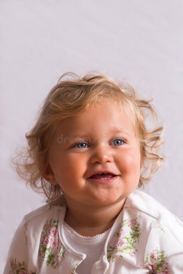 blond gullig flicka arkivfoto