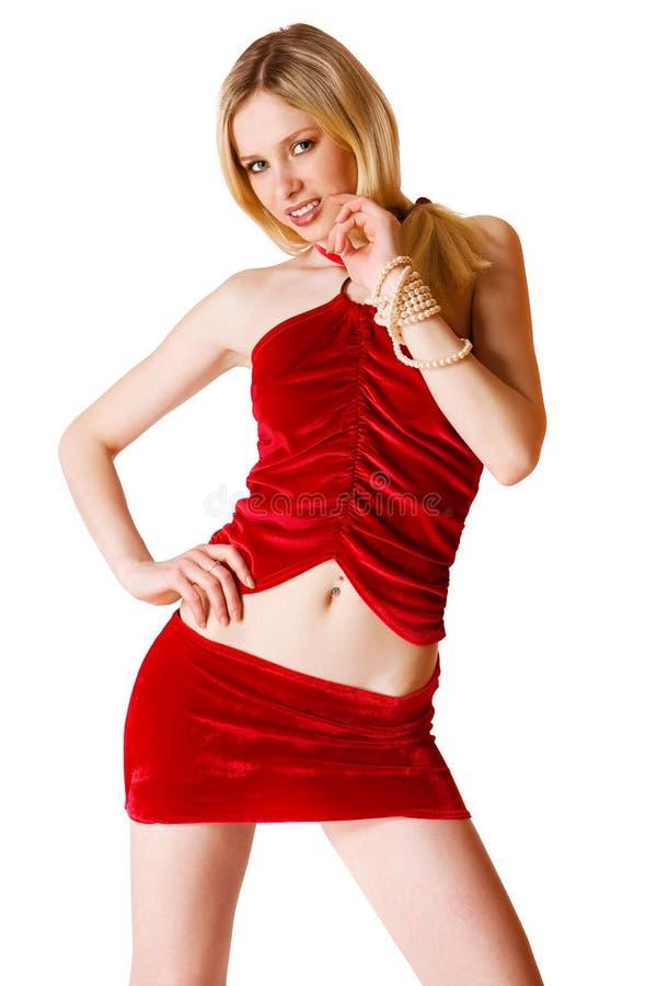 blond gullig flicka isolerat rött skirtbarn royaltyfri bild