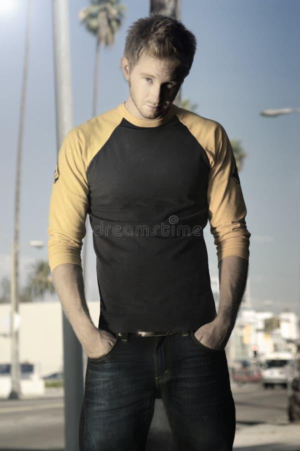 Free Blond Guy Standing On Sidewalk Stock Image - 6593151
