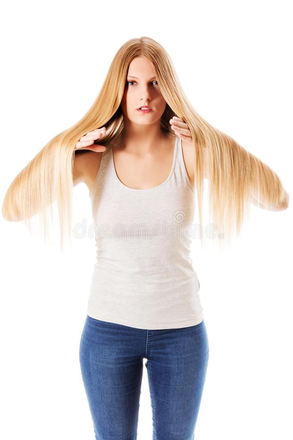 Blond hair. Beautiful woman with straight long hair. royalty free stock photos