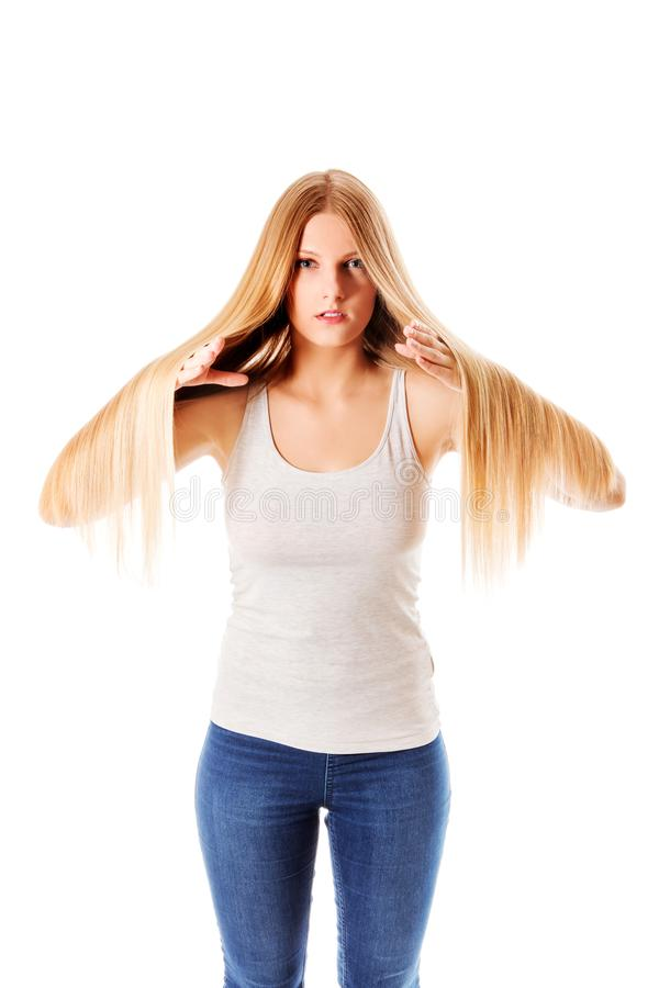 Blond hair. Beautiful woman with straight long hair. royalty free stock photography