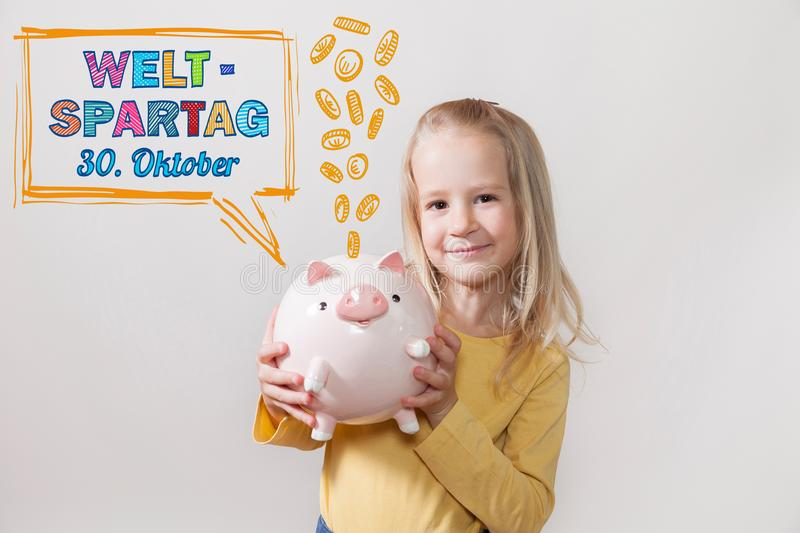Blond Hair Girl Piggy Bank Weltspartag 30 Oktober royalty free stock photo