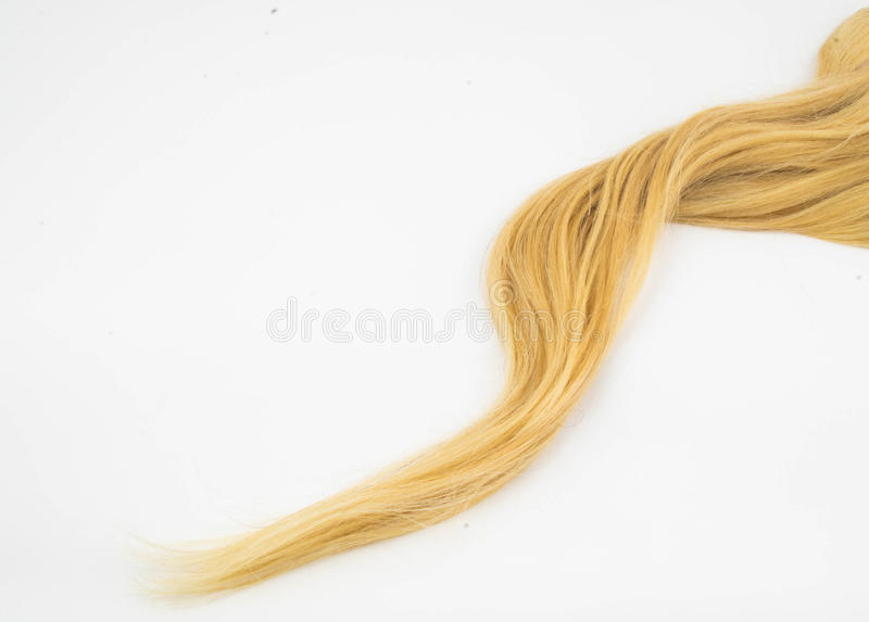Blond hair piece stock image