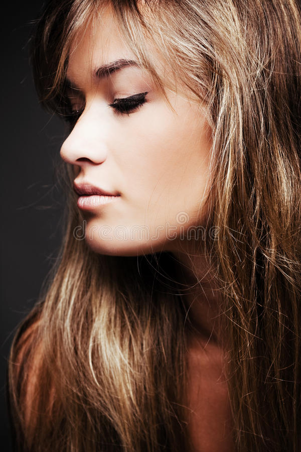 Blond hair woman profile. Beautiful blond young woman profile royalty free stock image