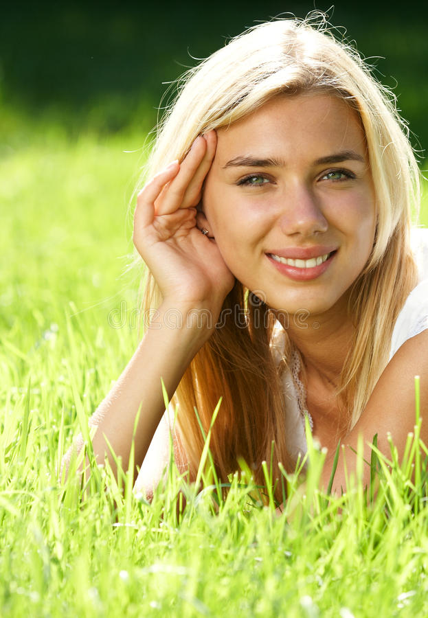 Download Blond haired teen on field stock image. Image of attractive - 16017123