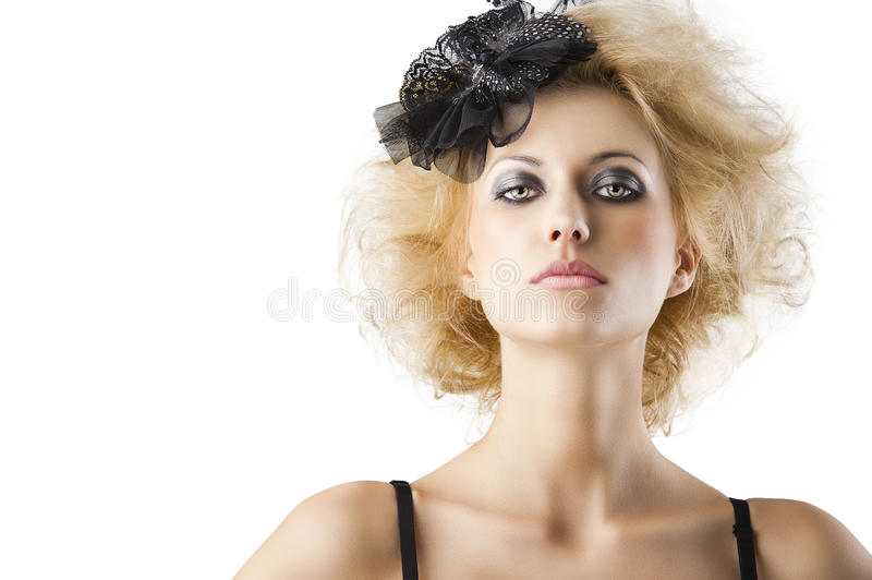 Blond hairstyle girl with bra underwear, she. Hair style with black accessory of a very beautiful blond girl wearing a black bra lingerie, she is in front of the stock photos