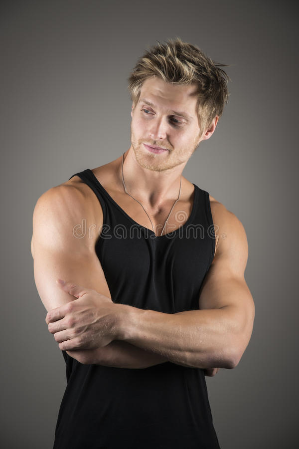 Blond handsome man in black shirt stock images