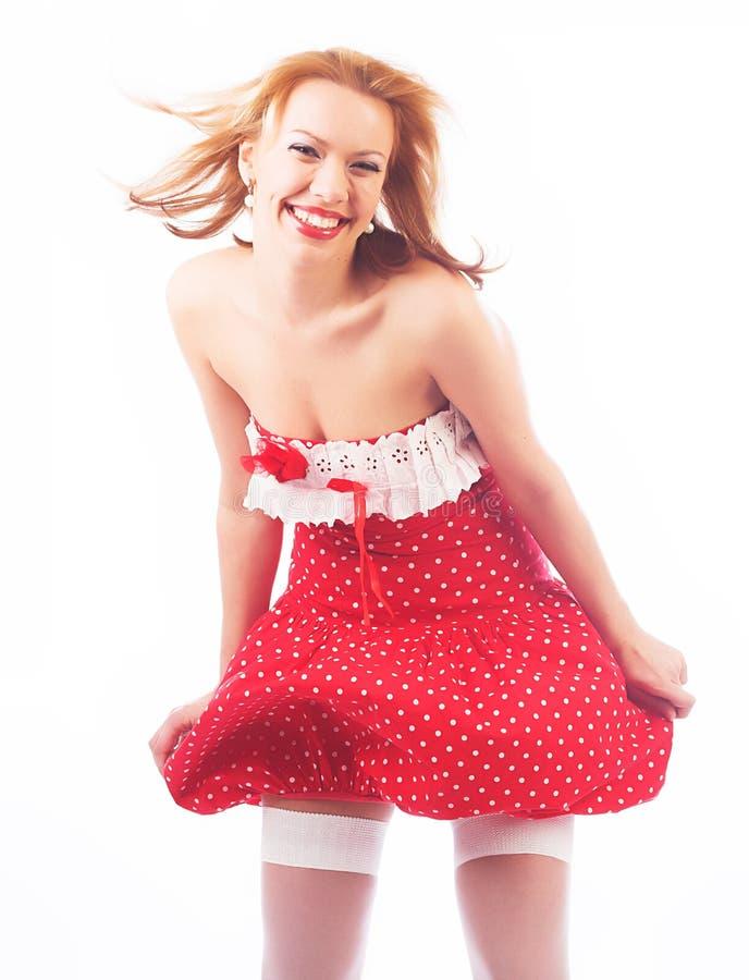 Blond im roten Kleid stockfotos