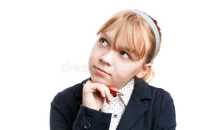Blond Kaukasisch denkend geïsoleerd schoolmeisje royalty-vrije stock afbeelding