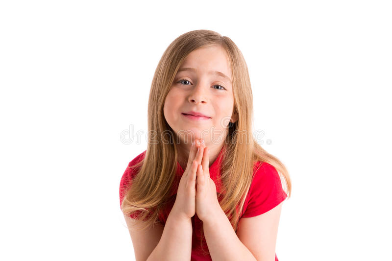 Blond kid girl praying hands gesture in white stock images