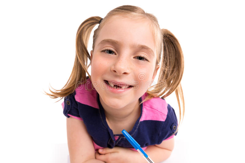 Blond kid girl student with spiral notebook in desk stock images