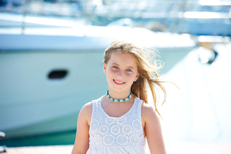 Blond kid teen girl in Mediterranean port Spain. Blond kid teen girl in Mediterranean port of Spain royalty free stock photography