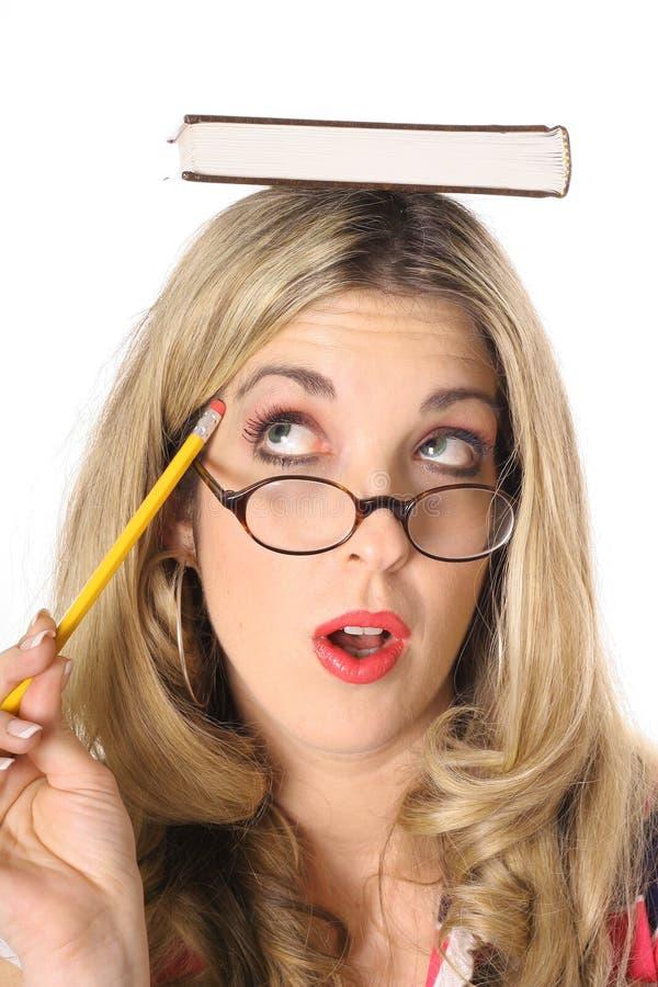 blond książki głowy myślące kobiety obrazy royalty free