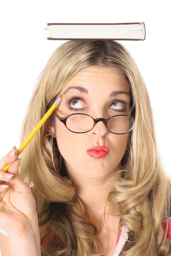 blond książki głowy usta myślące kobiety obrazy stock