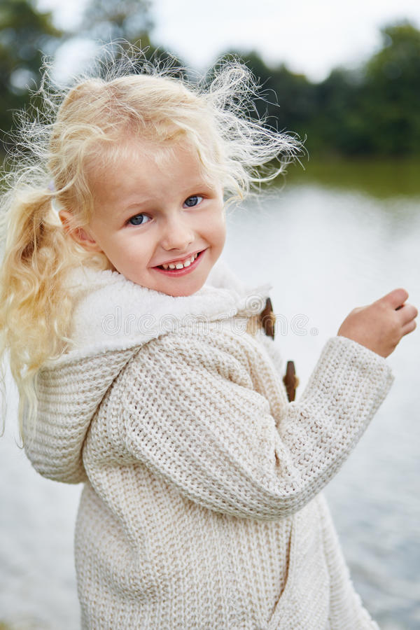 Blond little girl with curls royalty free stock images