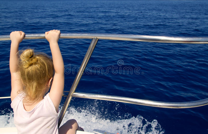Blond Little Girl Rear View Sailing In Boat Stock Photography