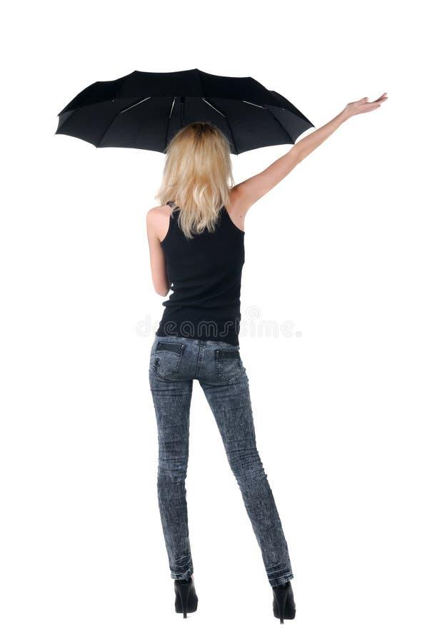 Blond młoda kobieta pod parasolem Odizolowywający nad bielem obraz stock