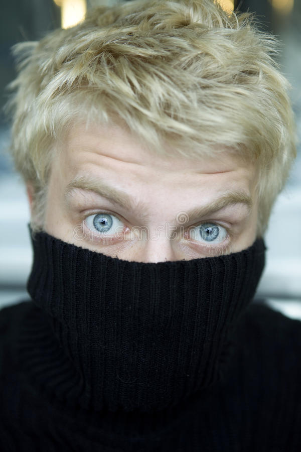 Download Blond Man Pull On Black Sweater Stock Photo - Image of astonished, hide: 10797606