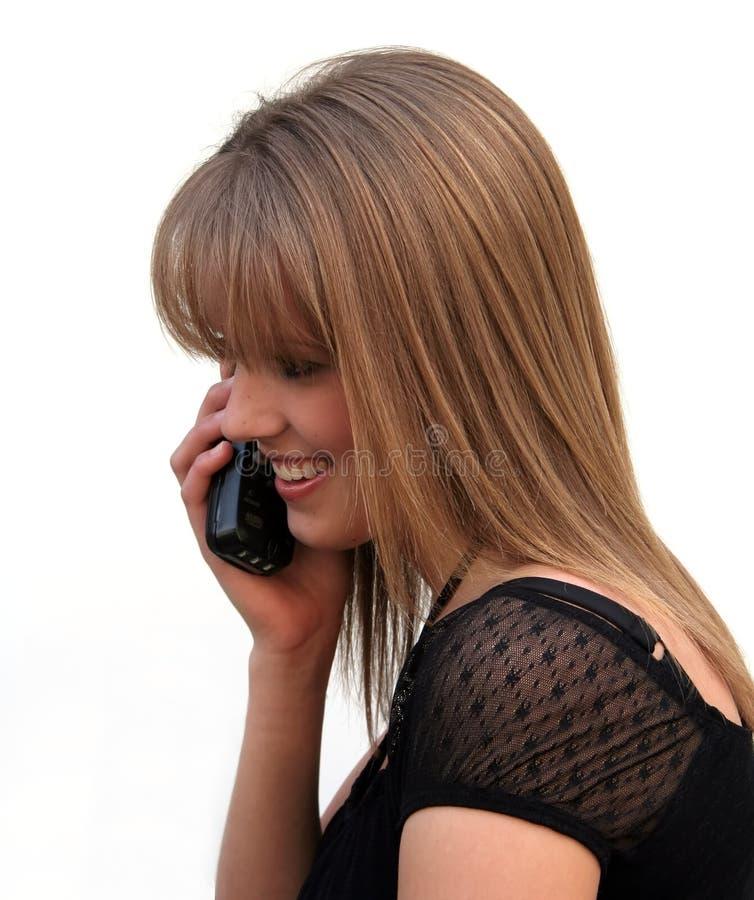 Blond meisje op de telefoon stock afbeeldingen