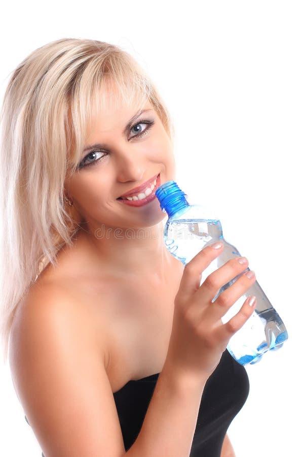 blond mit Flasche stockbild
