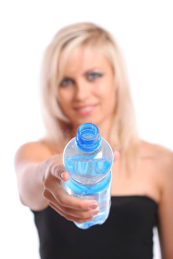 Blond mit Flasche stockbilder