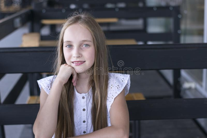 Blond model sitting at cafe stock photos
