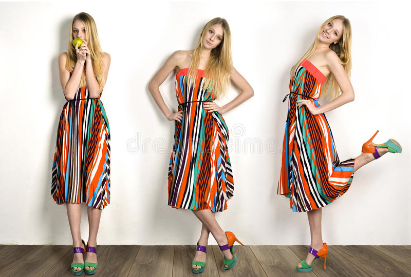 Blond model in a striped dress stock images