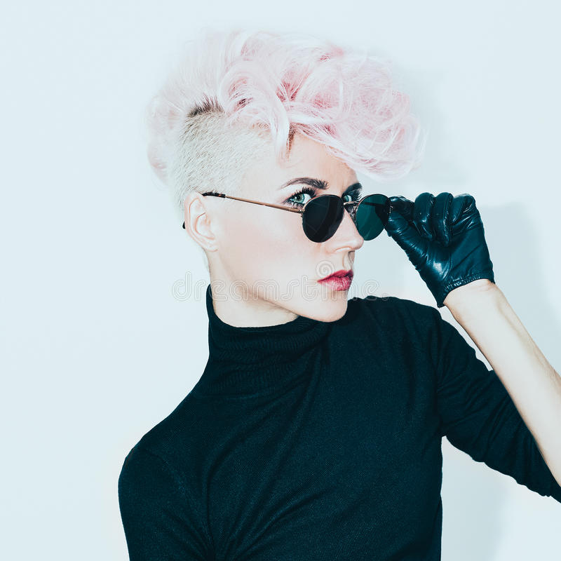 Blond model in vintage glasses with stylish haircut. fashion photo stock photos