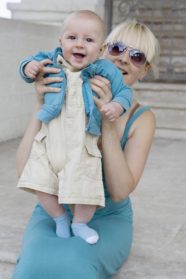 Download Blond Mother Holding  Her Smiling Baby Stock Image - Image: 10835597