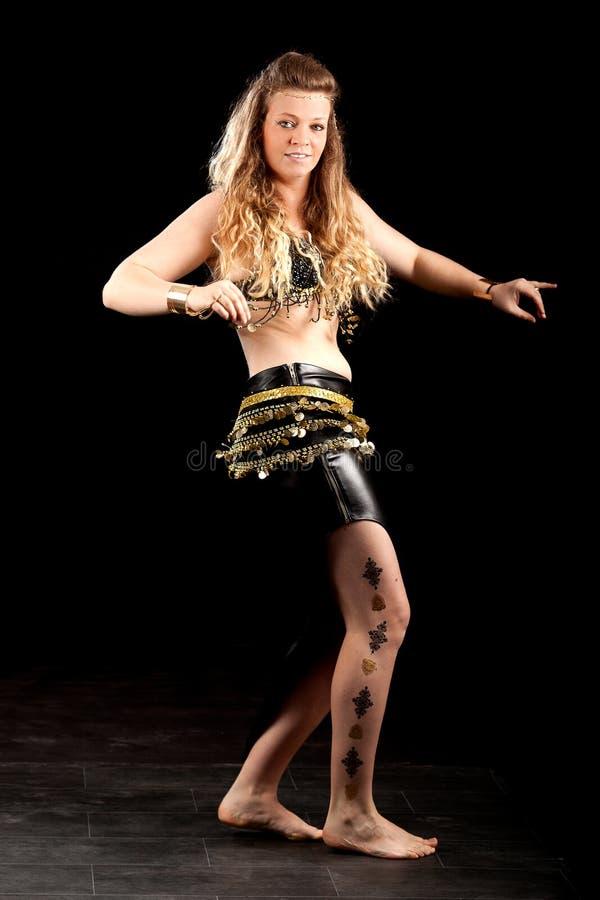 Blond oriental belly dancer stock images