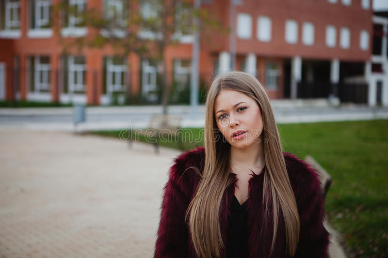 Blond pretty girl with long hair. In the street royalty free stock photography