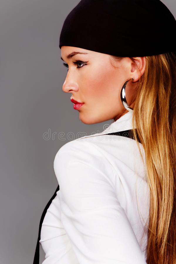 Blond pretty woman profile. Blond woman profile in white shirt and black head scarf stock photography