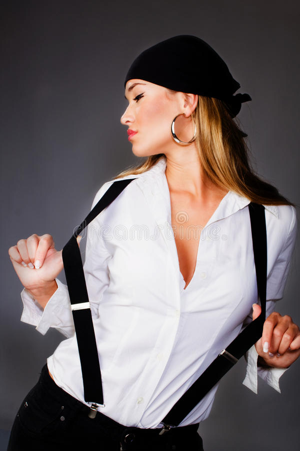 Blond pretty woman in white shirt. Blond woman in white shirt and black suspenders and head scarf royalty free stock photography