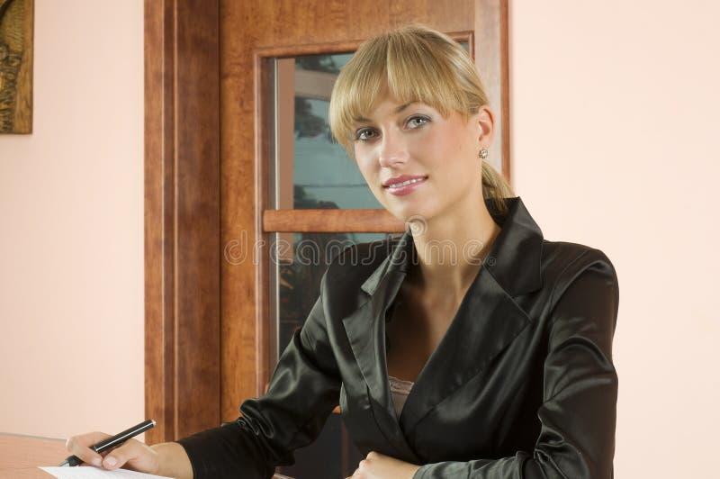 Blond receptionist stock photos