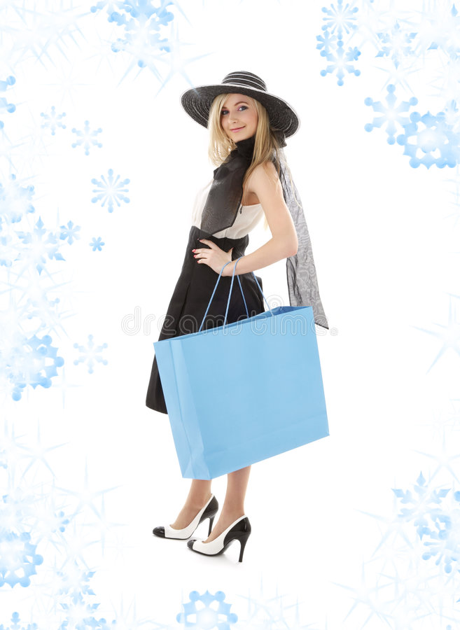 Blond In Retro Hat With Blue Shopping Bag Stock Image